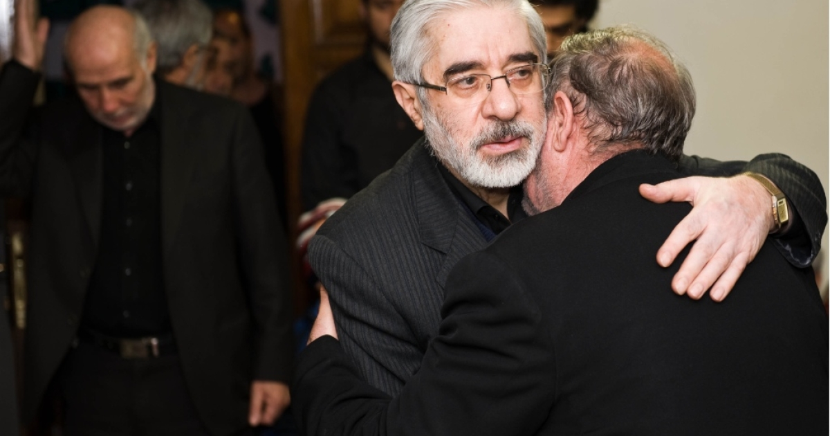 Iranian opposition leader Mir Hossein Mousavi (C) receives condolences for the death of his nephew Seyed Ali Habibi-Mousavi, on December 28, 2009 in Tehran. The 35-year-old nephew of Mir Hossein Mousavi was shot dead in Tehran during protests on December 27 which turned into the bloodiest showdown between opposition protesters and security forces in months. Iranian police said on December 29 that 'terrorists' killed the nephew of opposition leader Mir Hossein Mousavi in an incident unrelated to anti-government riots at the weekend.</p>
