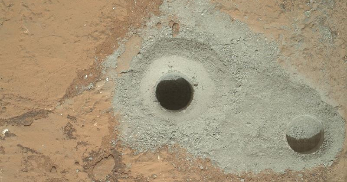 At the center of this image from NASA's Curiosity rover is the hole in a rock called