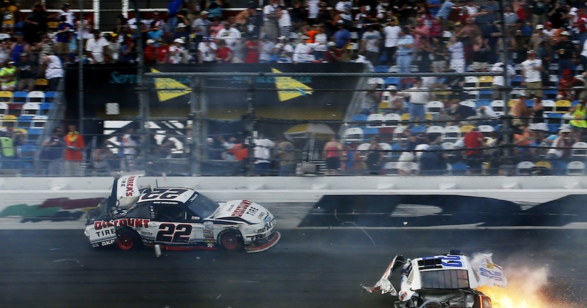 DAYTONA BEACH, FL - FEBRUARY 23: Kyle Larson, driver of the #32 Clorox Chevrolet, and Regan Smith, driver of the #7 Clean Coal Chevrolet, are involved in an incident at the finish of the NASCAR Nationwide Series DRIVE4COPD 300 at Daytona International Speedway on February 23, 2013 in Daytona Beach, Florida.</p>