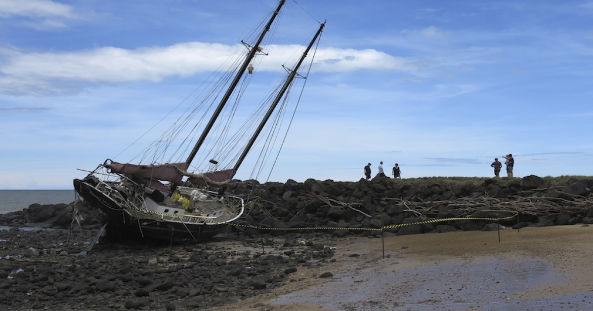 This picture taken on Jan. 28, 2013 shows the twin masted yacht the 'Patricia Mary' washed up on Baraga beach in Bundaberg after the passing of tropical cyclone Oswald.</p>