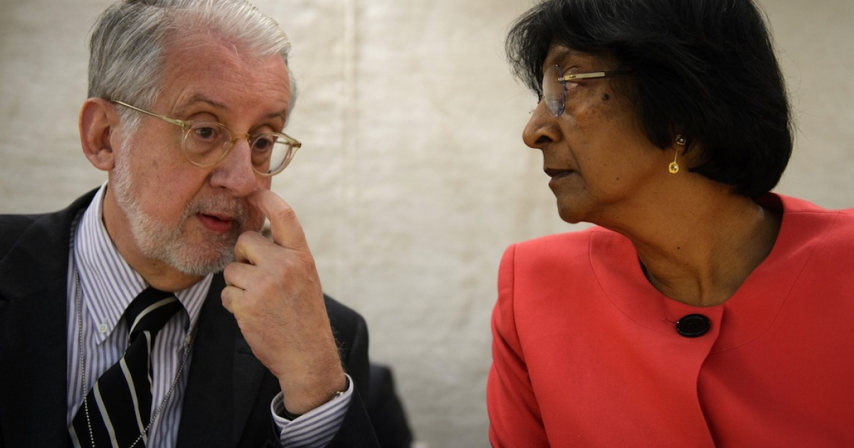 The head of the United Nations' Independent Commission of Inquiry on Syria, Paulo Sergio Pinheiro (L) speaks with UN Human Rights Commissioner Navi Pillay during a session of the UN Human Right Council in Geneva. The Council meets again this week to discuss the Vienna Declaration and Programme of Action and assess future plans.</p>