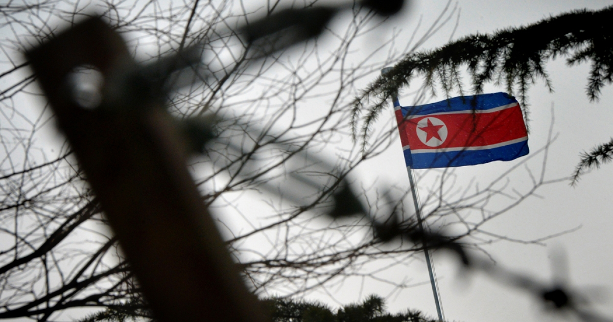 The North Korean flag flies outside their embassy in Beijing on Dec. 12, 2012.</p>