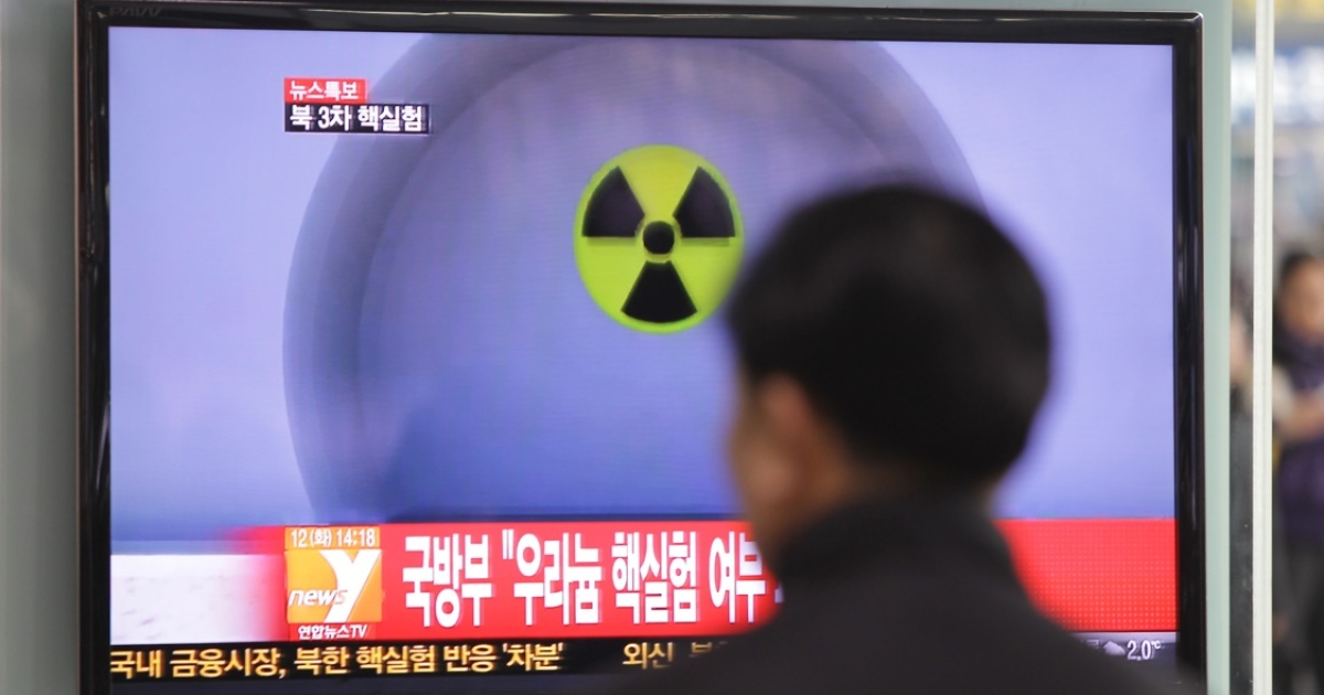 People watch a television report on North Korea's nuclear test on February 12, 2013 in Seoul, South Korea.</p>