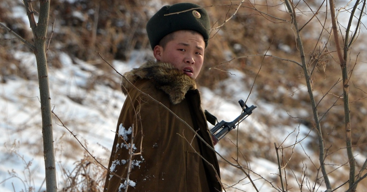 A North Korean soldier patrols along the Yalu River near the North Korean town of Sinuiju across from the Chinese city of Dandong, after the country conducted its third nuclear test on Feb. 12.</p>