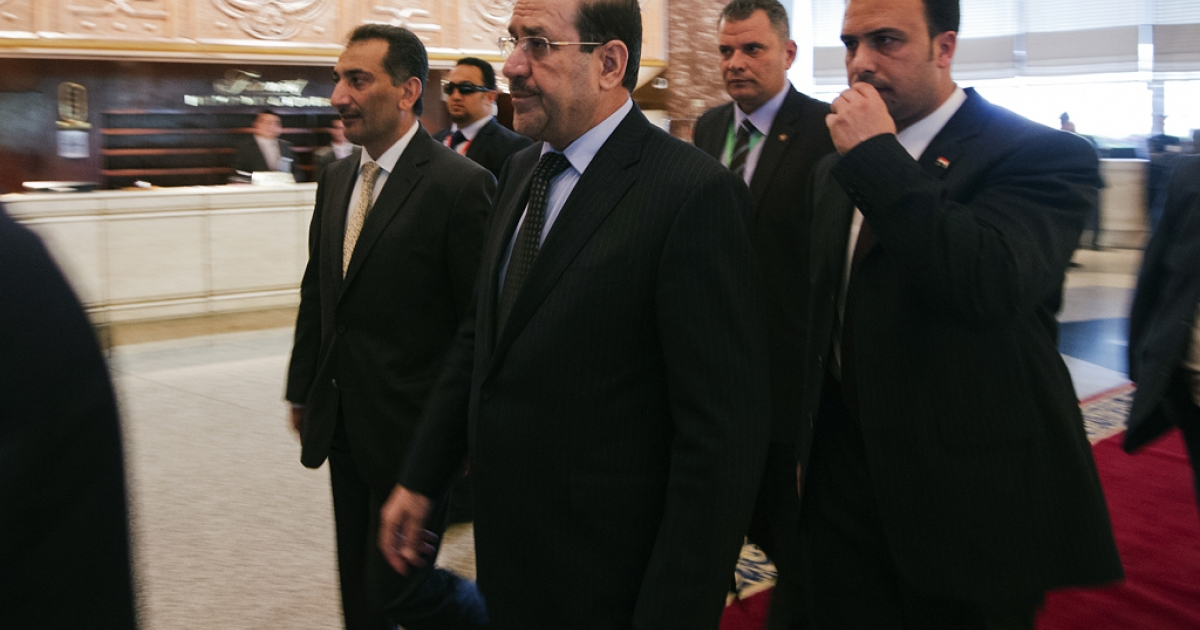 Iraq Prime Minister Nouri al-Maliki (C) arrives to attend the 12th summit of the Organisation of Islamic Cooperation on February 6, 2013, in Cairo.</p>