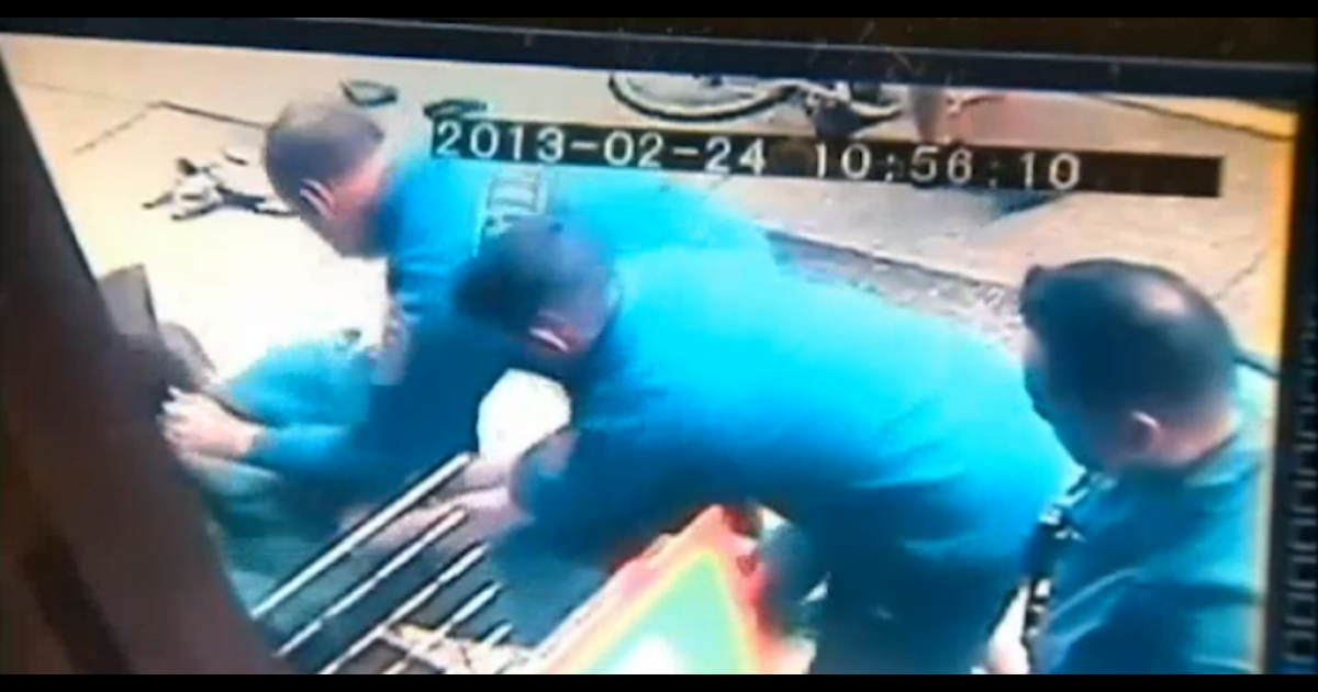 A screengrab of security footage that shows NYC firefighters rescuing a women from her husband's assault.</p>