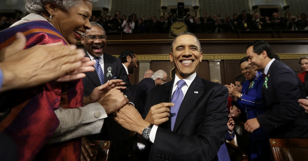 President Barack Obama arrives at Congress to deliver his State of the Union address</p>