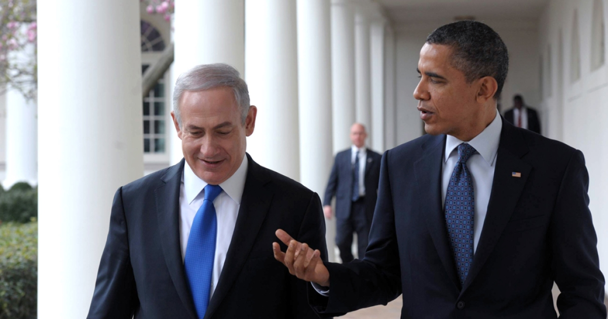 In this handout photo from the Israeli Government Press Office (GPO), U.S. President Barack Obama (R) talks with Prime Minister Benjamin Netanyahu as they walk along the Colonnade of the White House on March 5, 2012 in Washington, DC. Obama is planning to visit Israel in the spring of 2013.</p>