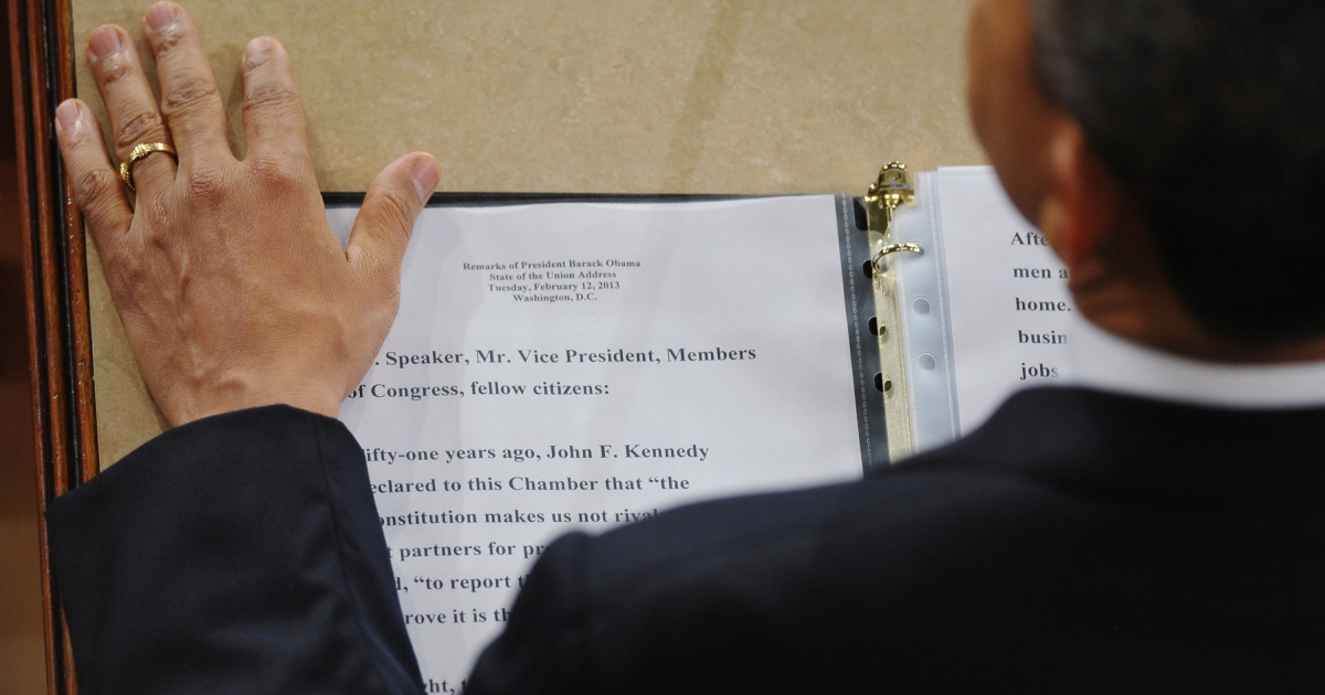 President Barack Obama rests his hand next to a copy of his speech as he delivers his State of the Union address before a joint session of Congress on February 12, 2013 at the US Capitol in Washington, DC.</p>