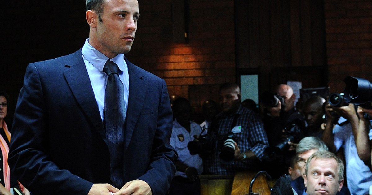South African Olympic sprinter Oscar Pistorius appears at the Magistrate Court in Pretoria on February 22, 2013. Pistorius battled to secure bail as he appeared on charges of murdering his model girlfriend Reeva Steenkamp on February 14, Valentine's Day. South African prosecutors will argue that Pistorius is guilty of premeditated murder in Steenkamp's death, a charge which could carry a life sentence. Pistorius denies the charge, saying that he shot 29-year-old Steenkamp repeatedly through a locked bathroom door in the dead of night by accident, having mistaken her for a burglar.</p>