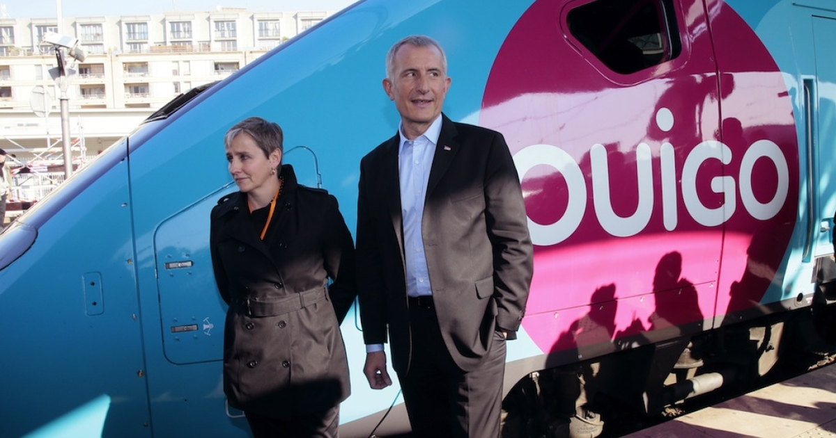 France's national rail company SNCF head, Guillaume Pepy (R) and Valerie Dehlinger (G) director of the 'Ouigo' project, pose in front of the new low-cost TGV high-speed train 'Ouigo' at the Gare de Lyon railway station in Paris on Feb. 19, 2013</p>