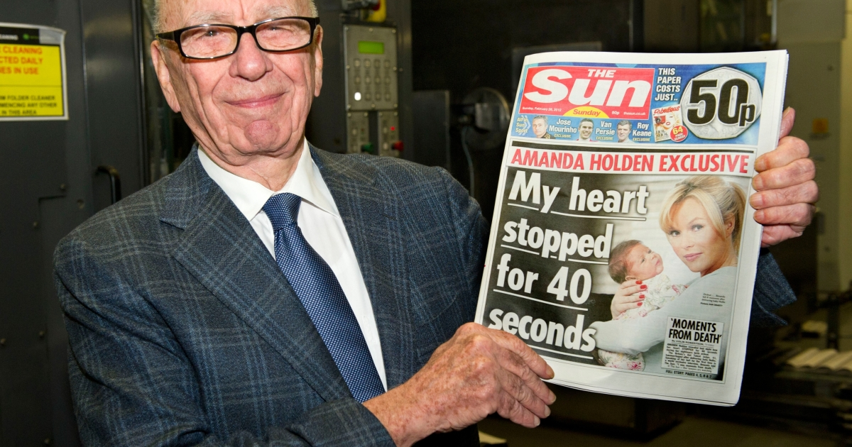 Rupert Murdoch with the first edition of The Sun On Sunday in Broxbourne, England, on Feb. 25, 2012.</p>