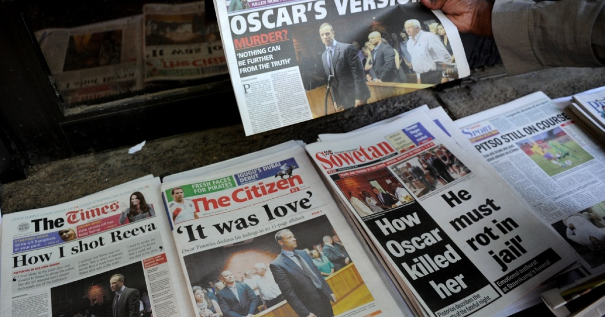 Front pages of South African newspapers featuring Olympic sprinter Oscar Pistorius' Feb. 19 court appearance are displayed on February 20, 2013 outside the Magistrate Court in Pretoria. Pistorius battled on Feb. 20 to secure bail as he appeared on charges of murdering his model girlfriend Reeva Steenkamp on Feb. 14, Valentine's Day. South African prosecutors argue that Pistorius is guilty of premeditated murder in Steenkamp's death, a charge which could carry a life sentence.</p>