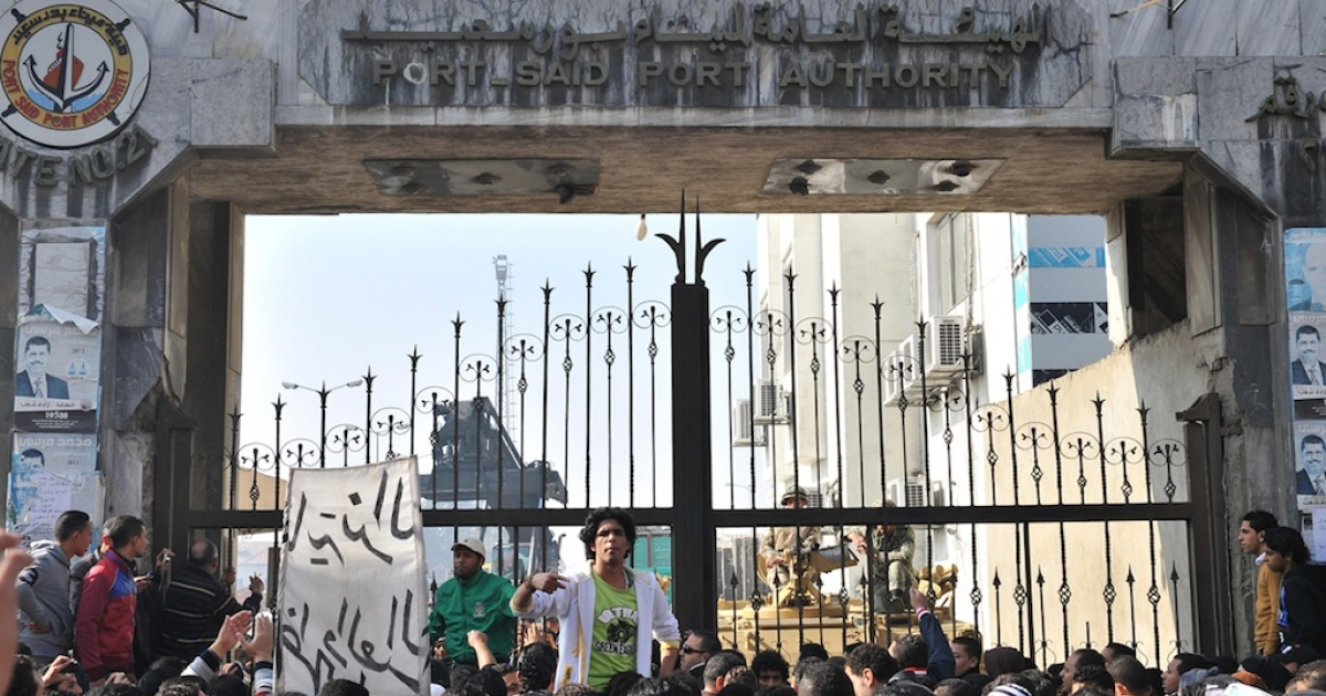 Thousands of Egyptians protest and close down government offices and factories in the Suez Canal city of Port Said on Feb. 17, 2013.</p>