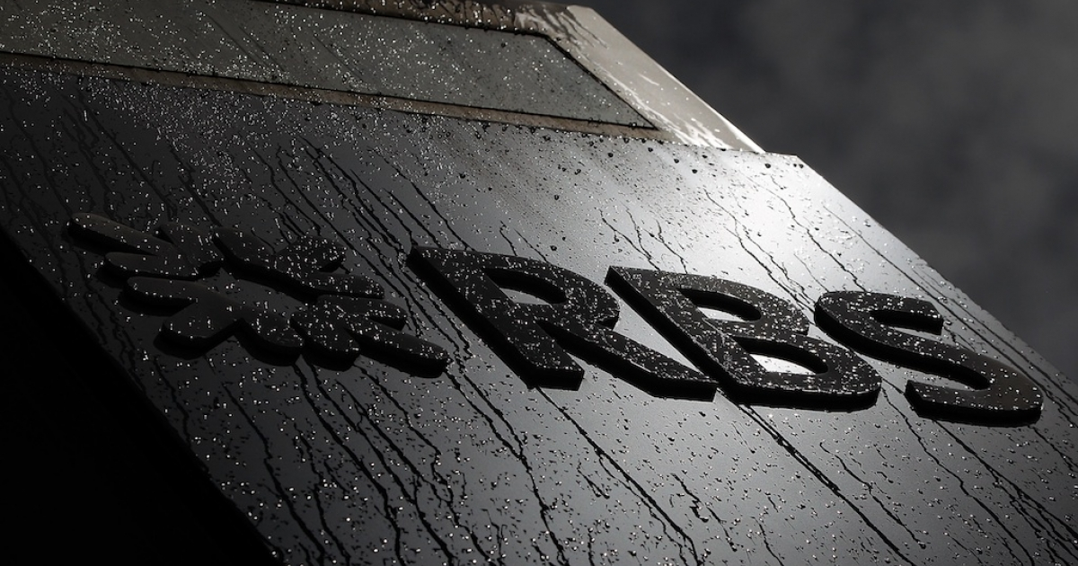 The Royal Bank of Scotland (RBS) logo is covered in raindrops outside their building on Bishopsgate on August 3, 2012 in London, England. The bank is the latest to be fined over its involvement in the LIBOR rate-fixing scandal.</p>