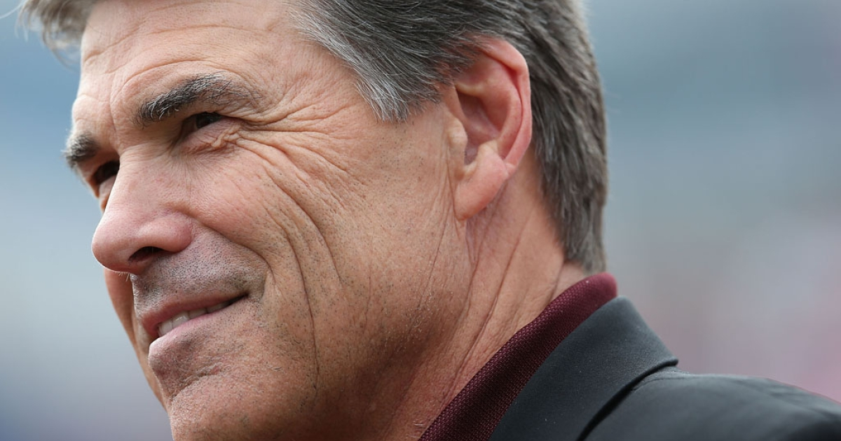 Texas Gov. Rick Perry watches a college football game between the Texas A&amp;M Aggies and the Southern Methodist Mustangs at Ford Stadium on September 15, 2012 in Dallas, Texas.</p>