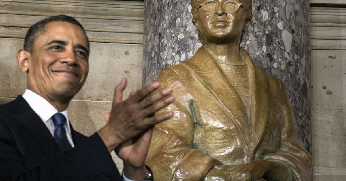 US President Barack Obama applauds after unveiling a statue of Rosa Parks during an unveiling in Statuary Hall on Capitol Hill February 27, 2013 in Washington, DC.</p>