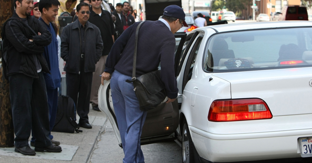 A commuter gets into the car of a motorist willing to carpool on May 8, 2008, in San Francisco, Calif. SideCar operates using a mobile app, which allows people to call cars and drivers to their current location.</p>