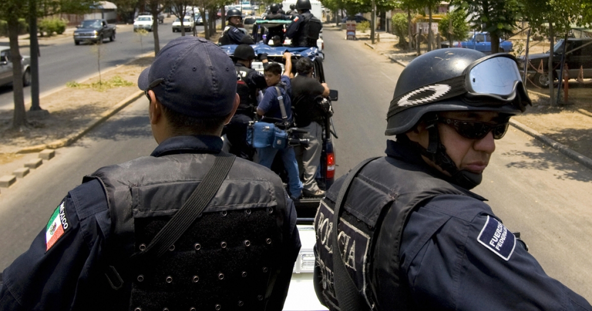Members of the Mexican Federal Police patrol the city of Culiacan, a northwestern city in Mexico's Sinaloa state, on May 28, 2008. Ever since former president Felipe Calderon deployed thousands of soldiers and federal police to combat organized crime in 2006, the country has been ravaged by violence.</p>