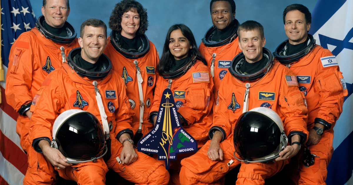 The crew of Space Shuttle Columbia's mission STS-107 pose for the traditional crew portrait. Seated in front are astronauts Rick D. Husband (L), mission commander; Kalpana Chawla, mission specialist; and William C. McCool, pilot. Standing are (L to R) astronauts David M. Brown, Laurel B. Clark, and Michael P. Anderson, all mission specialists; and Ilan Ramon, payload specialist representing the Israeli Space Agency.</p>