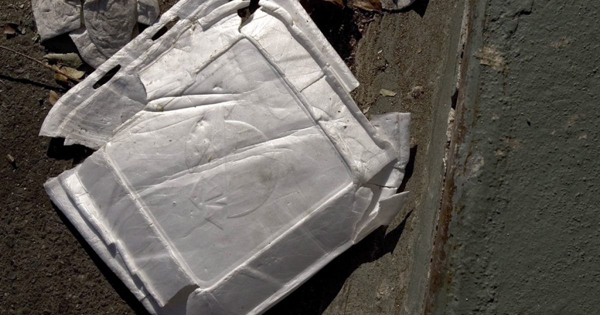 Used Styrofoam containers are seen on the streets of Oakland, Calif.</p>
