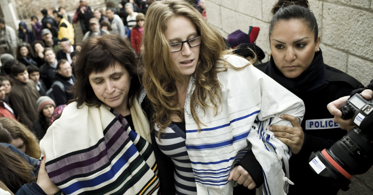Israeli police arrest American Rabbi Susan Silverman (left), sister of comedian Sarah Silverman, and her teenage daughter Hallel Abramowitz (center), after performing Rosh Hodesh prayers at the Western Wall in Jerusalem, on Feb. 11, 2013.</p>