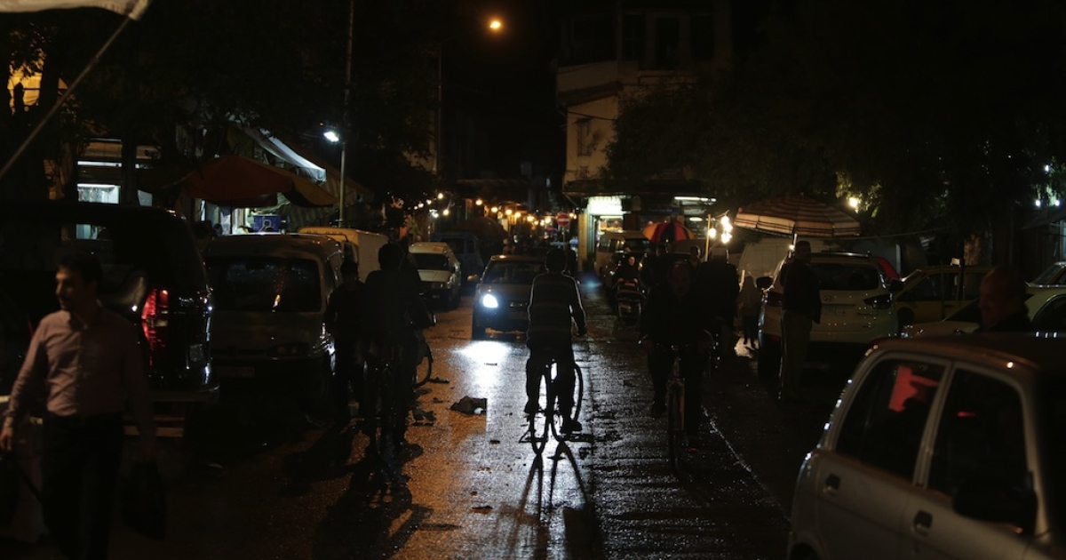 A general view shows Syrians shopping on a street in Damascus at night on November 11, 2012.</p>