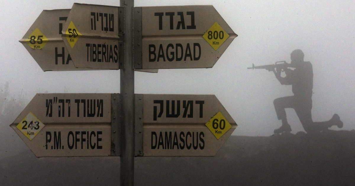 A sculpture of an Israeli soldier standing guard is seen next to a sign for tourists showing the different distances to Jerusalem, Baghdad, Damascus and other locations, at an army post in Mount Bental in the annexed Golan Heights on January 31, 2013. Iran's deputy foreign minister said that the alleged Israeli air strike on a Syrian military research facility a day earlier will have 'grave consequences.'</p>