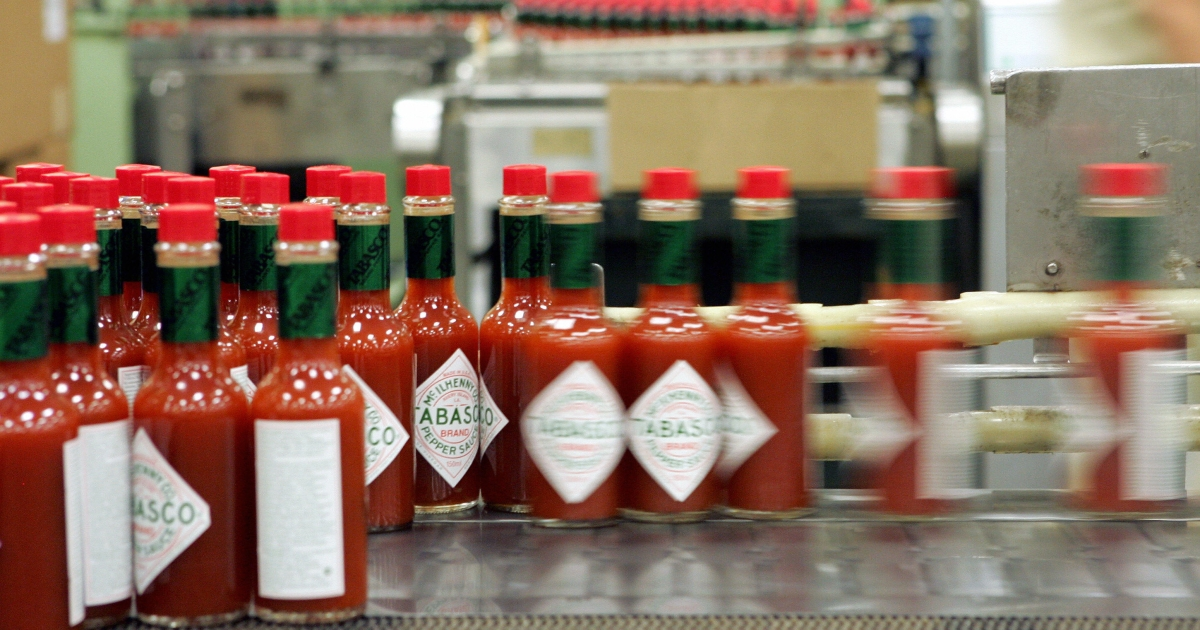 A line of bottles of McIlhenny Tabasco Sauce are shown at the McIlhenny Company inside the plant at Avery Island, Louisiana 14 September 2005. The sauce was created by Edmund McIlhenny in 1868 and the same process is still in use today.</p>