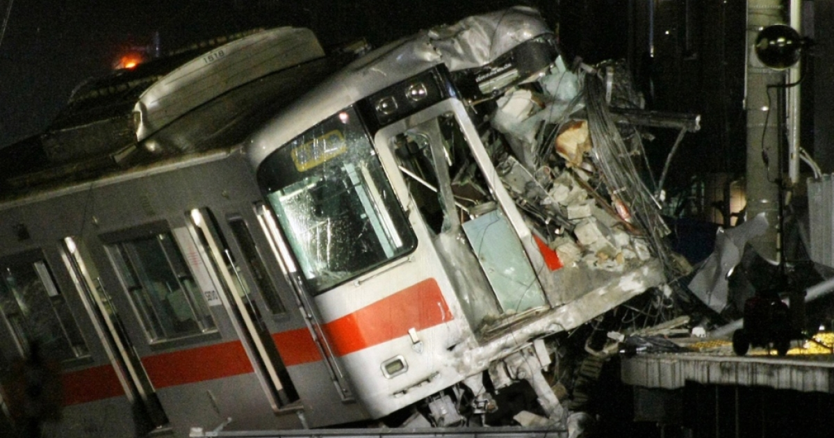 A passenger train of the Sanyo Electric Railway is derailed after the train hit a truck at a level crossing in Takasago city in Hyogo prefecture, western Japan on February 12, 2013. An express passenger train hit a truck at a level crossing in Japan on February 12, police said, with footage and reports from the scene showing it had mounted a station platform.</p>