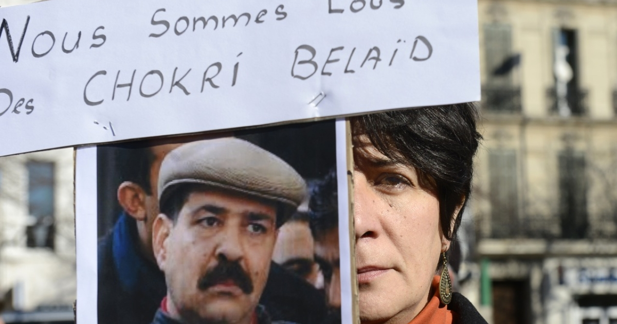 A woman holds a sign reading 'We are all some Chokri Belaid' during a protest to pay tribute to the murdered Tunisian opposition leader on February 9, 2013, in Marseille, southern France.</p>