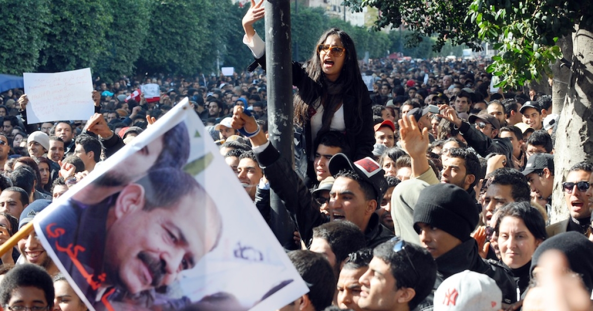 Protesters shout slogans outside the Interior Ministry to protest the death of Chokri Belaid (featured on the poster), who was shot dead on Feb. 6, 2013 in Tunis.</p>
