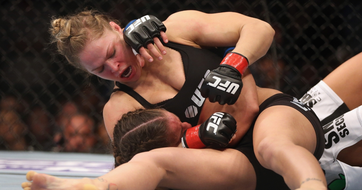 Ronda Rousey fights Liz Carmouche during their UFC bantamweight title bout at Honda Center on February 23, 2013, in Anaheim, California.</p>