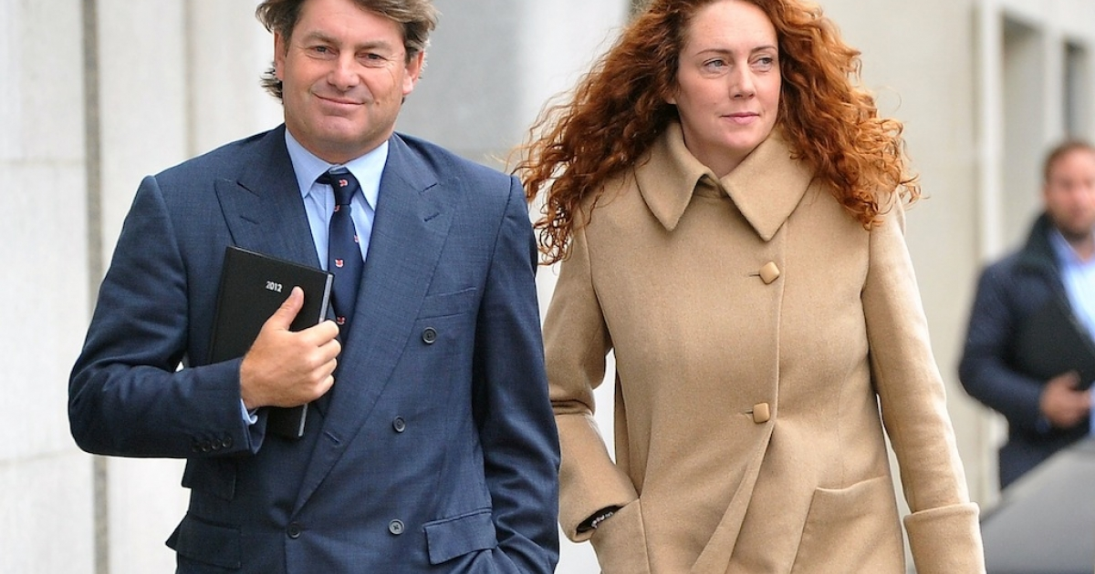 Former News of the World editor Rebekah Brooks and her husband Charlie Brooks arrive at the Old Bailey court in central London on Sept. 26, 2012 in London, England.</p>
