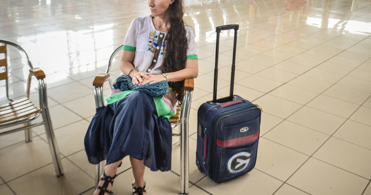 Cuban blogger Yoani Sanchez waits for the check-in to open upon departing from Havana's airport for Brazil on Feb. 17.</p>