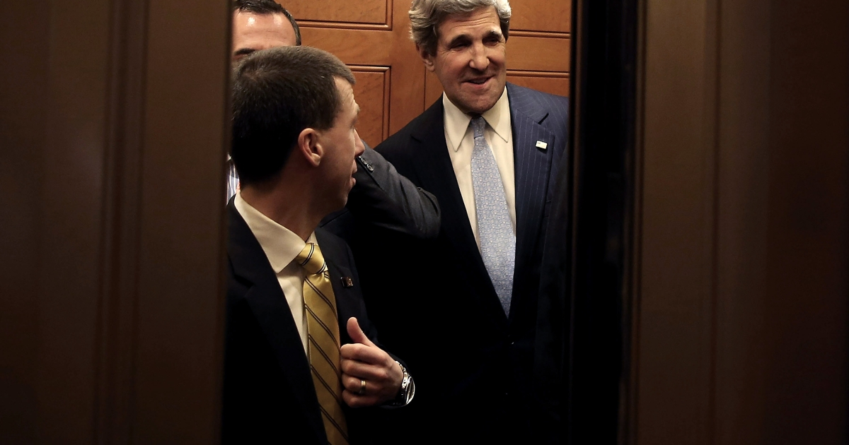Sen. John Kerry (D-MA) is surrounded by security officers as he leaves from the Senate floor in a elevator after the full Senate voted on him to become Secretary of State, on January 29, 2013 on Capitol Hill in Washington DC.</p>
