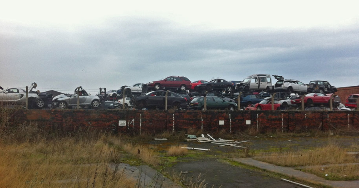 Crashed and abandoned cars at the riverside in Middlesbrough.</p>