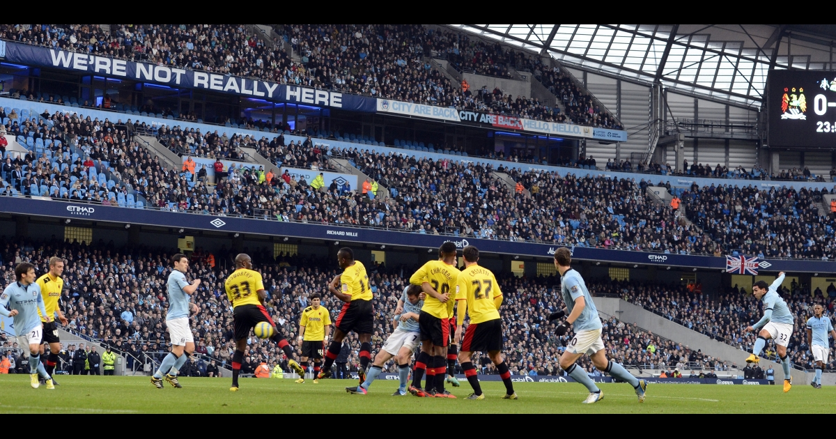 Manchester City's Argentine striker, Carlos Tevez, (R) scores from a free kick during the English FA Cup third round soccer match between Manchester City and Watford at The Etihad stadium in Manchester, England on Jan. 5.</p>