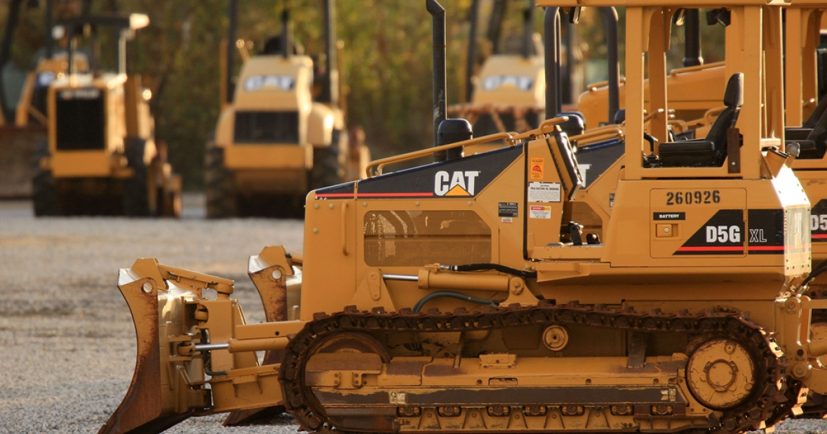 Heavy Caterpillar machinery stands at Quinn Co. Caterpillar on Jan. 26, 2009, in City of Industry, Calif. The biggest international manufacturer of construction equipment, Caterpillar, posted sharply lower profits for 2012 due to weak demand among its dealers and a charge connected with accounting fraud at a Chinese subsidiary</p>