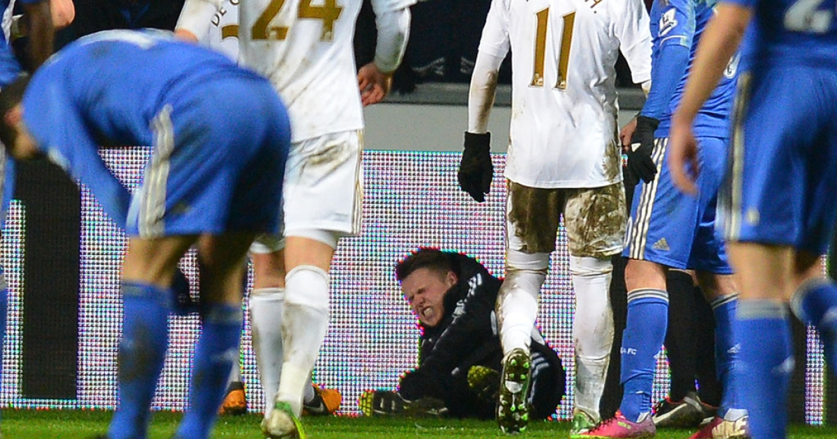 Ball boy Charlie Morgan lies on the ground after an altercation with Chelsea midfielder Eden Hazard during the English League Cup semifinal match at Swansea City in Cardiff, Wales, on January 23, 2013. After the incident Hazard was sent off by referee Chris Foy.</p>