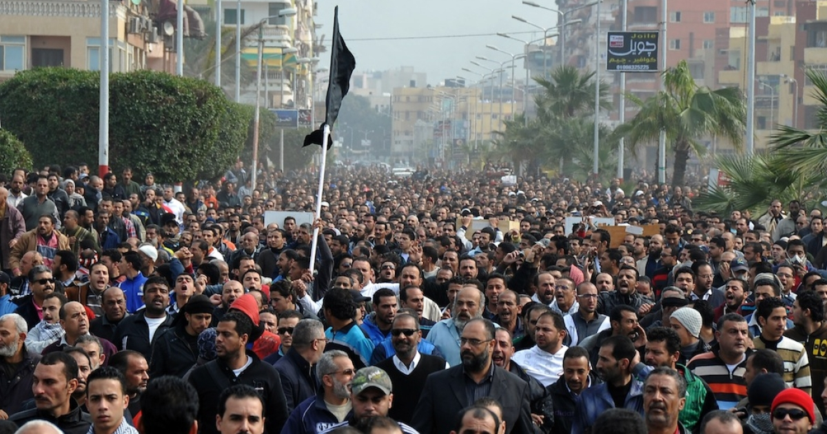 Egyptian mourners march in a funeral for six people killed in clashes in the canal city of Port Said on Jan. 28, 2013.</p>