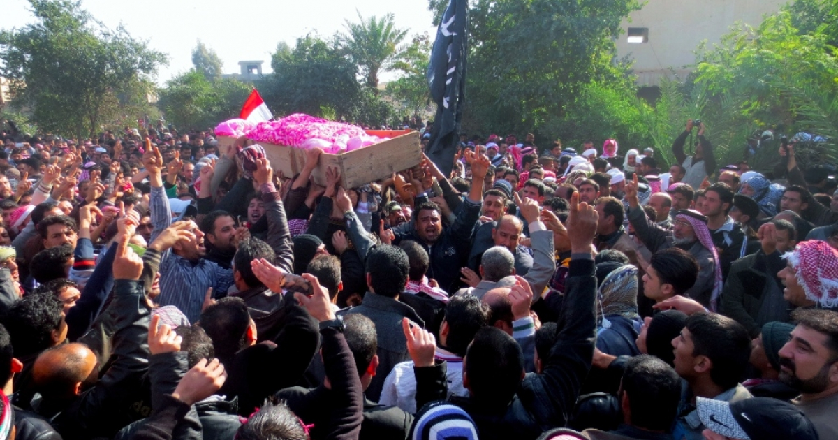 Iraqis take part in the funeral of one of people killed by Iraqi troops the day before during a protest in the town of Fallujah, west of the Iraqi capital Baghdad on January 26, 2013. The deaths in the predominantly Sunni town were the first since protests began last month, and came as tens of thousands rallied in Sunni areas of the country, railing against alleged targeting of their minority by the Shiite-led authorities.</p>