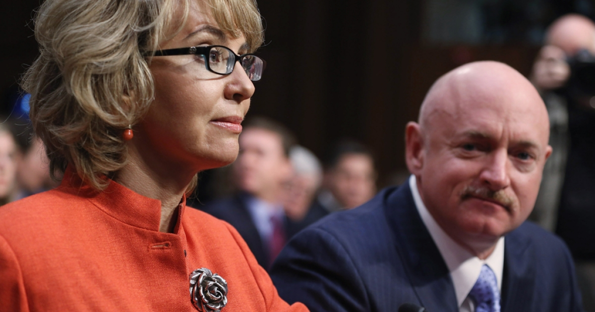 Shooting victim and former US Rep. Gabby Giffords (D-AZ) (L) prepares to give an opening statement before the Senate Judiciary Committee during hearing about gun control while her husband Retired NASA astronaut and Navy Capt. Mark Kelly (2nd L) watches on Capitol Hill January 30, 2013 in Washington, DC. Giffords delivered an opening statment to the committee, which met for the first time since the mass shooting at a Sandy Hook Elementary School in Newtown, Connecticut.</p>