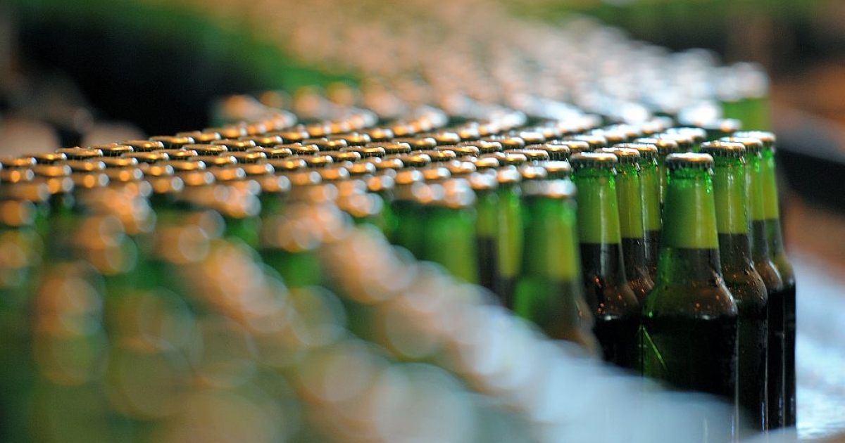 A happy sight for Prince Pils, bottles of beer are seen at the production line of Dutch brewer Heineken factory.</p>