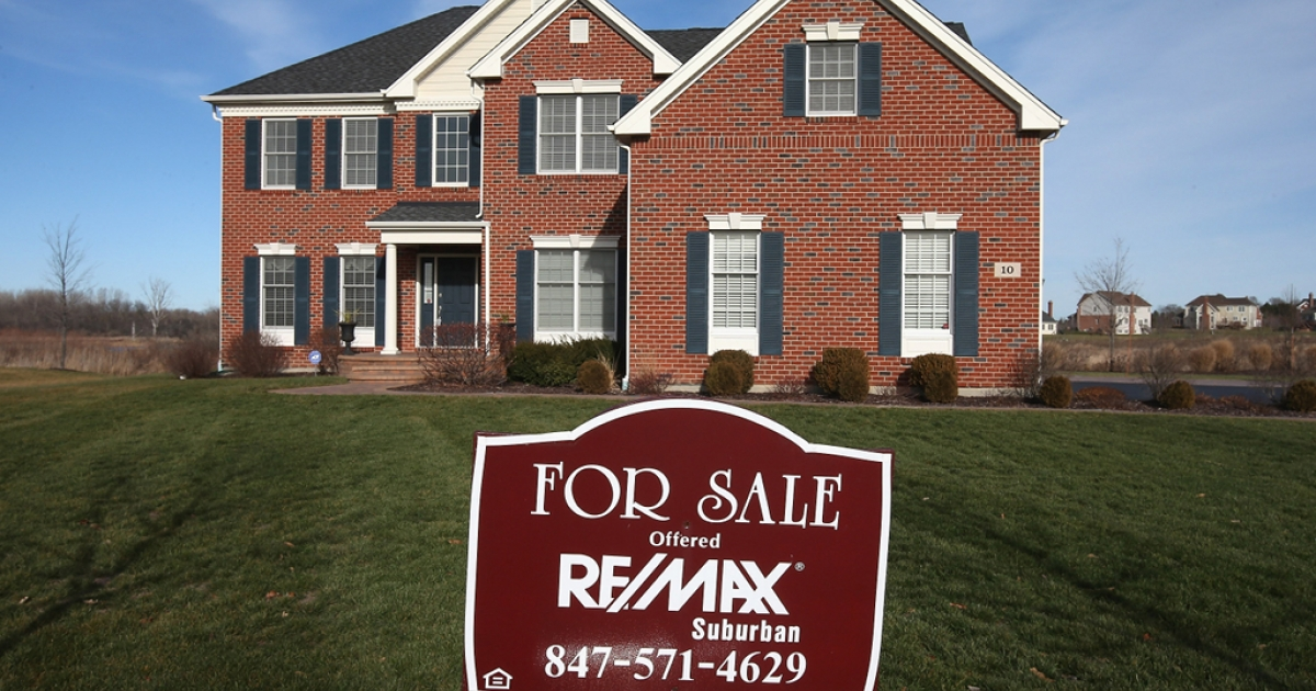 A home is offered for sale by Remax Realty in a Toll Brothers housing development on Dec. 4, 2012 in South Barrington, Illinois.</p>
