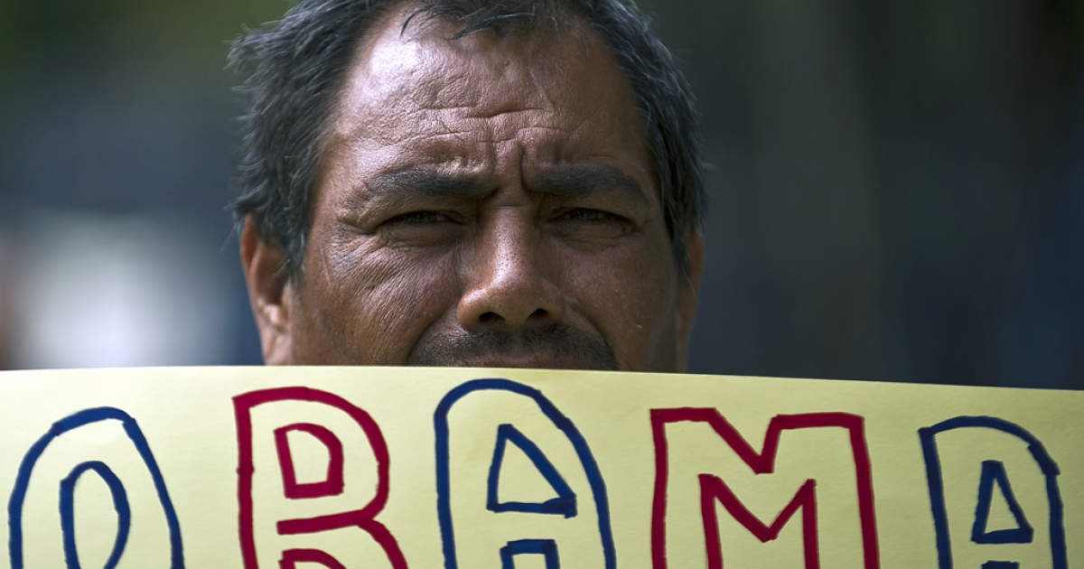 A Mexican man holds a sign during a protest in front of the US embassy against the failure of the US immigration reform, on Jan. 21, 2013, in Mexico City.</p>