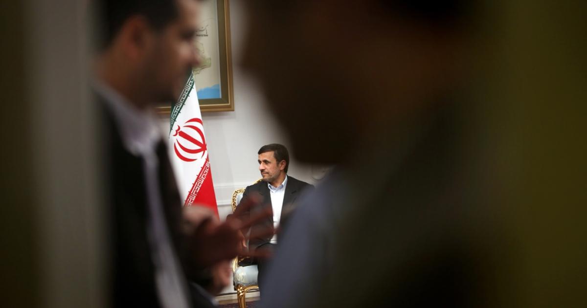 Iranian President Mahmoud Ahmadinejad (C) meets with Syrian Prime Minister Wael al-Halaqi (unseen) in Tehran on January 15, 2013.</p>