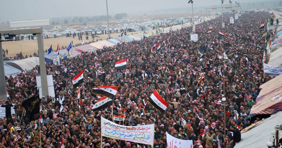 Anti-government protesters perform the weekly Friday prayer in the western Iraqi city of Ramadi on January 25, 2013. The longest-running of the protests, in Ramadi, has cut off a key trade route linking Baghdad to Jordan and Syria for a month.</p>