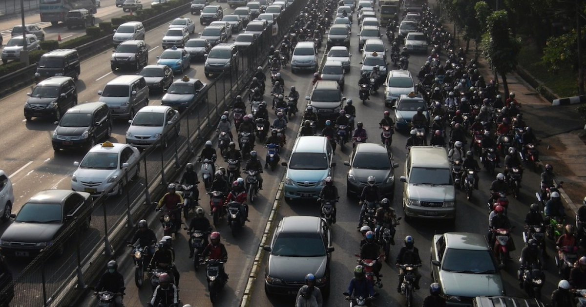 Commuter vehicles queue in a gridlock during rush hour traffic in Jakarta on September 7, 2012. At least 1,000 new vehicles are added every day to the streets of Jakarta, where some eight million cars crawl through one of Asia's worst traffic jams every day, according to private and government studies.</p>