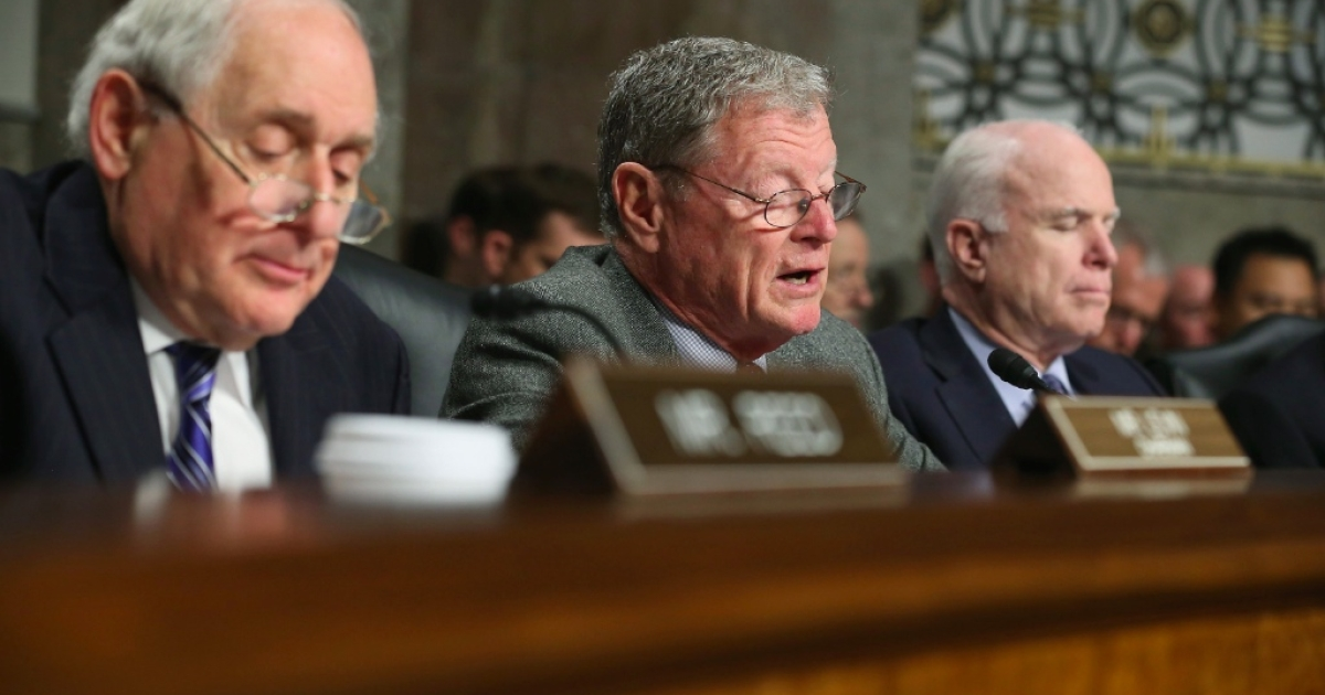 Senate Armed Services Committee ranking member Sen. Jim Inhofe (R-OK) delivers opening remarks during former U.S. Sen. Chuck Hagel's (R-NE) confirmation hearing to become the next secretary of defense with Chairman Carl Levin (D-MI) (L) and Sen. John McCain (R-AZ) on Capitol Hill January 31, 2013 in Washington, DC. President Barack Obama nominated Hagel, a controversial choice as Hagel opposed former President George W. Bush and his own party on the Iraq War and upset liberals with his criticism of a gay ambassador, for which he later apologized.</p>